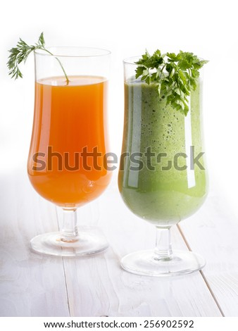 Healthy green smoothie and carrot juice