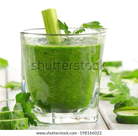 Healthy green smoothie in a glass.  Selective focus