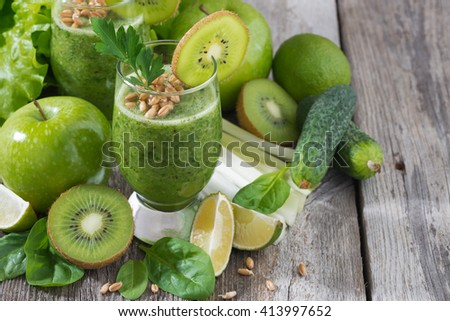 healthy green smoothie with sprouts on a wooden background, close-up, horizontal