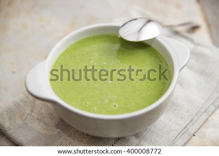 Healthy green soup in a bowl - stock photo