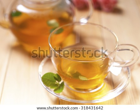 healthy green tea cup with tea leaves  - stock photo