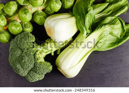 Healthy green vegetables, organic sprouts, broccoli and chinese cabbage pak choi - stock photo