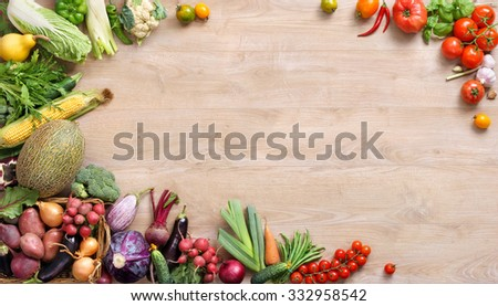 Healthy group of fresh vegetables and fruits on a wooden background / studio photography of different fruits and vegetables on old wooden table. High resolution product. - stock photo