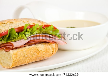 Healthy ham sandwich with a vegetable cream soup on the side. Shallow depth of field. - stock photo