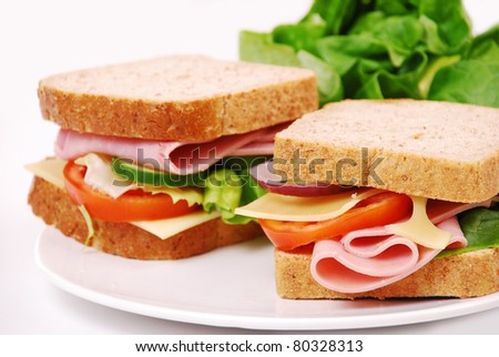 Healthy ham sandwich with cheese, tomatoes on white background