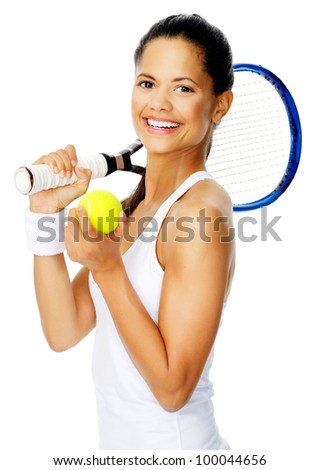 Healthy happy hispanic woman with a wristband poses with a tennis racket while holding tennis ball - stock photo
