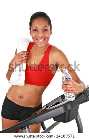 Healthy Happy Young African American Female Standing on Treadmill Isolated - stock photo