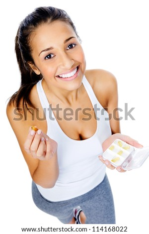 Healthy heart woman with omega 3 capsule to show a balanced diet and good cardiovascular health - stock photo
