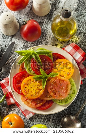 Healthy Heirloom Tomato Salad with Basil and Dressing - stock photo
