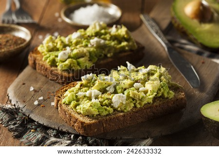 Healthy Homemade Avocado Toast with Salt and Feta - stock photo