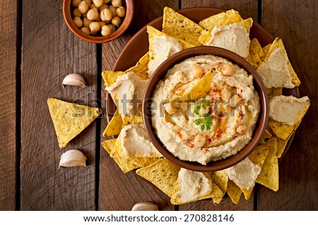 Healthy homemade  hummus with olive oil and pita chips. Top view - stock photo