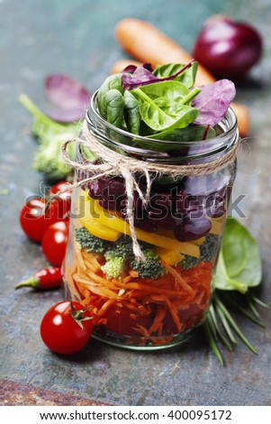 Healthy Homemade Mason Jar Salad with Beans and Veggies - Healthy food, Diet, Detox, Clean Eating or Vegetarian concept - stock photo