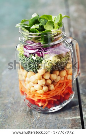 Healthy Homemade Mason Jar Salad with Chickpea and Veggies - Healthy food, Diet, Detox, Clean Eating or Vegetarian concept - stock photo