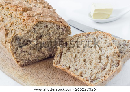 Healthy homemade oatmeal bread ready to eat on a white table. - stock photo