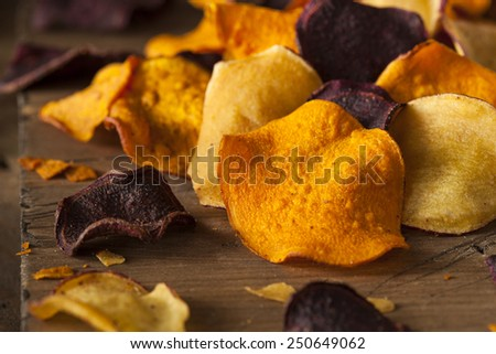 Healthy Homemade Vegetable Chips on a Cutting Board - stock photo