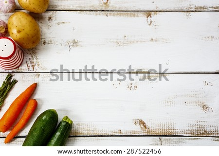 Healthy ingredients for cooking on white wooden background with space for text. Vegetarian food, health or cooking concept. - stock photo