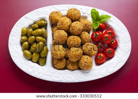 Healthy Italian Appetizer with Risotto Balls Arancini , green Olives , tomato and red Wine Sicilian homemade Snack - stock photo