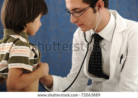 healthy kid boy , visiting a doctor - stock photo