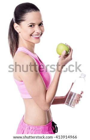 Healthy lady with a green apple - stock photo