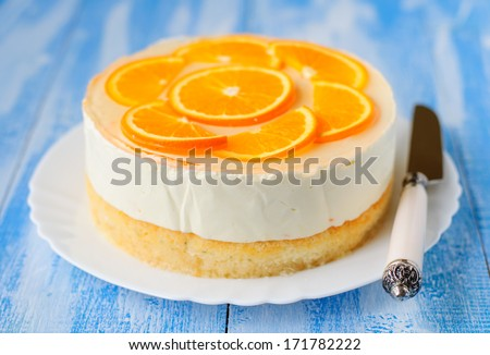 Healthy Layered Orange Cake: Syrup Soaked Sponge, Creamy Yoghurt Mousse, Oranges in Jelly - stock photo
