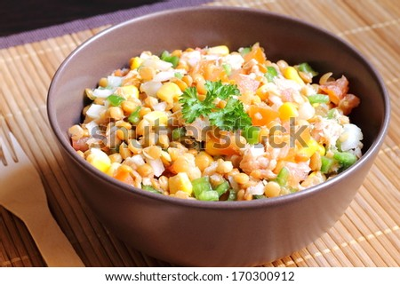 Healthy lentil salad with tuna, tomatoes, onions, green bell peppers and corn