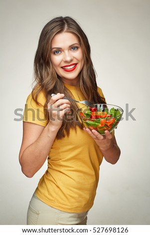 healthy life style with smiling woman eating vegetarian salad. isolated portrait.