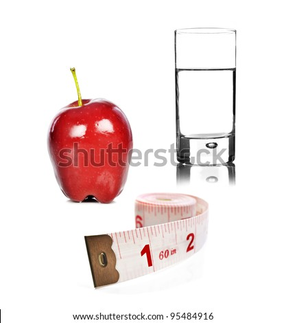 Healthy lifestyle - apple glass of water and tape measure on white background - stock photo