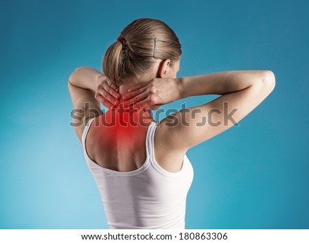 Healthy lifestyle. Back and spine disease. Close-up portrait of tired female massaging her neck.  - stock photo