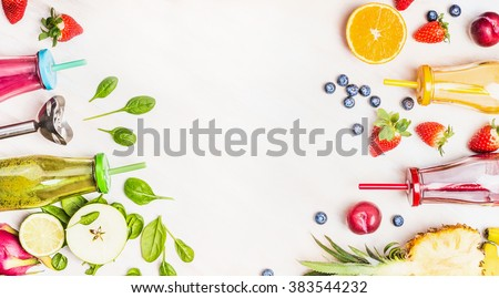 Healthy lifestyle background with various colorful smoothie drinks in bottles, blender and ingredients on white wooden. Detox and diet food concept. - stock photo