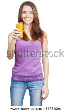 Healthy lifestyle. Beautiful brunette woman holding glass of juice - stock photo
