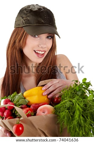 Healthy lifestyle - cheerful woman with fruit shopping paper bag on white background