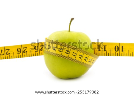 Healthy lifestyle concept. Green apple with measuring tape isolated on white background
