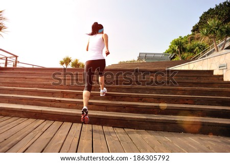 healthy lifestyle fitness sports woman running on wooden stairs - stock photo