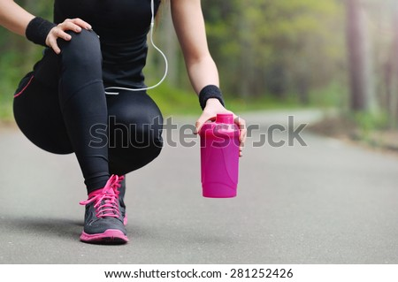 healthy lifestyle fitness sporty woman running early in the morning in forest area, healthy lifestyle concept - stock photo
