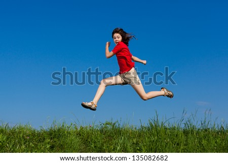 Healthy lifestyle - girl jumping, running outdoor