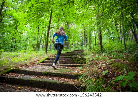 Healthy lifestyle - girl running, jumping in park  - stock photo