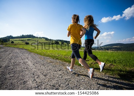 Healthy lifestyle - girls running, jumping outdoor  - stock photo