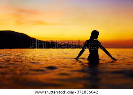 Healthy Lifestyle, Health Background. Silhouette Of Beautiful Young Woman Enjoying Sea Water And Sunset. Summer Travel Holidays Vacation. Happiness, Freedom, And Peace, Wellness, Body Care Concept.
