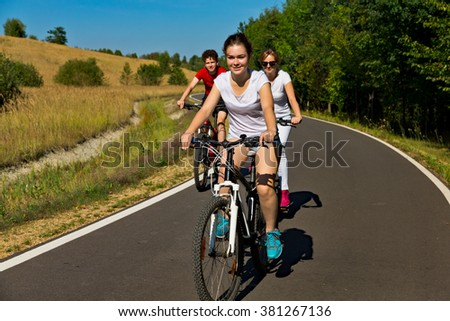 Healthy lifestyle - people riding bicycles  - stock photo