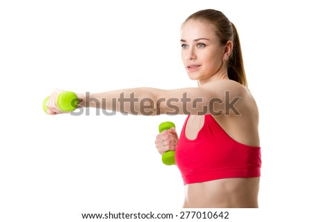Healthy lifestyle: portrait of young fitness model doing weight training, studio shot, white background, isolated