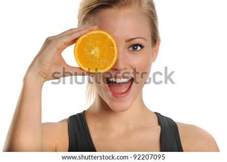 Healthy Lifestyle Portrait of Young Gorgeous Woman Playfully Holding Orange - stock photo