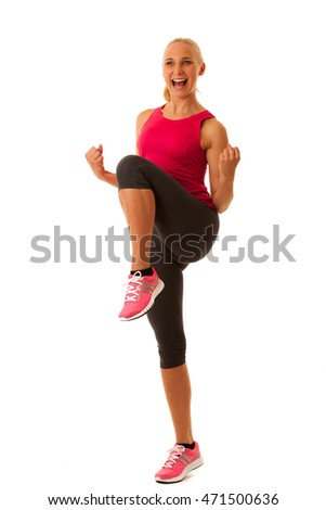 healthy lifestyle sport success - fit blond woman gesturing victory isolated over white background