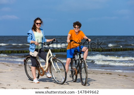 Healthy lifestyle - teenage girl and boy riding bikes  - stock photo
