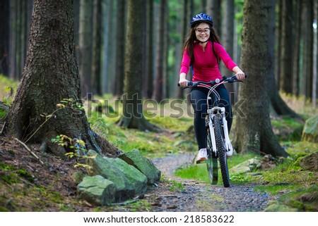 Healthy lifestyle - teenage girl cycling - stock photo