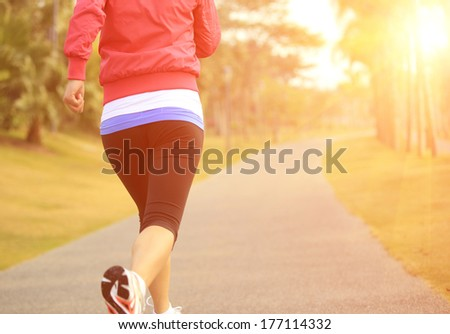 healthy lifestyle young asian woman running at tropical park