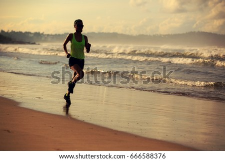 healthy lifestyle young fitness woman running on sunrise beach