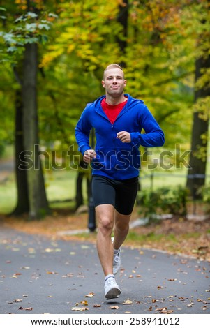 Healthy lifestyle - young man running - stock photo