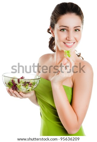 Healthy lifestyle - young woman eating salad  smiling happy looking at camera. - stock photo