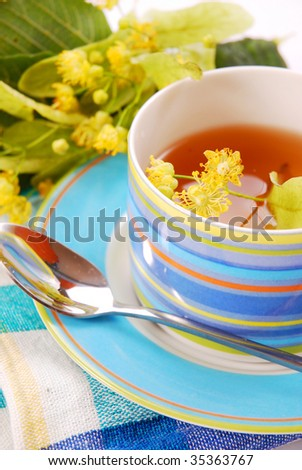 healthy linden tea in blue cup - stock photo