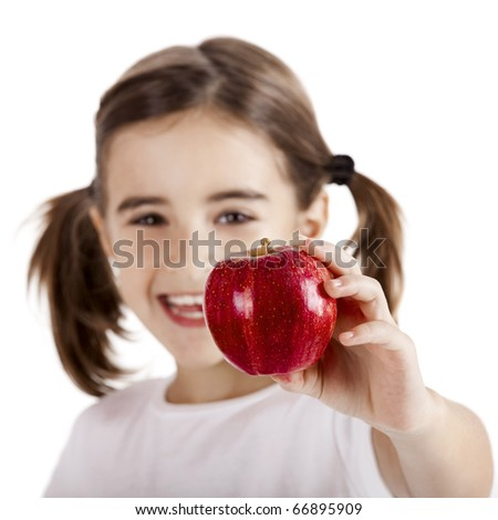 Healthy little girl holding and showing a red apple - stock photo